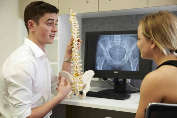 Murdoch Chiropractic student with spine model
