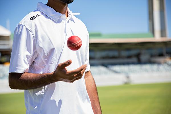 cricketer holding a cricket ball