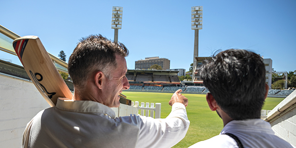 Mike hussey with a student