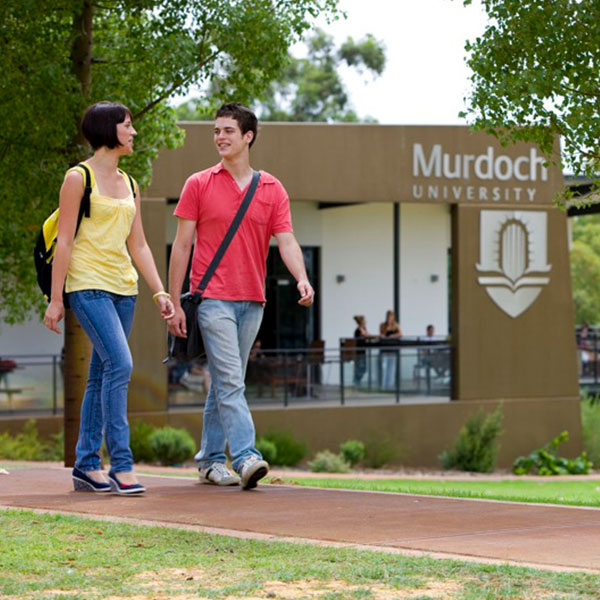 male and female student walking safely on campus