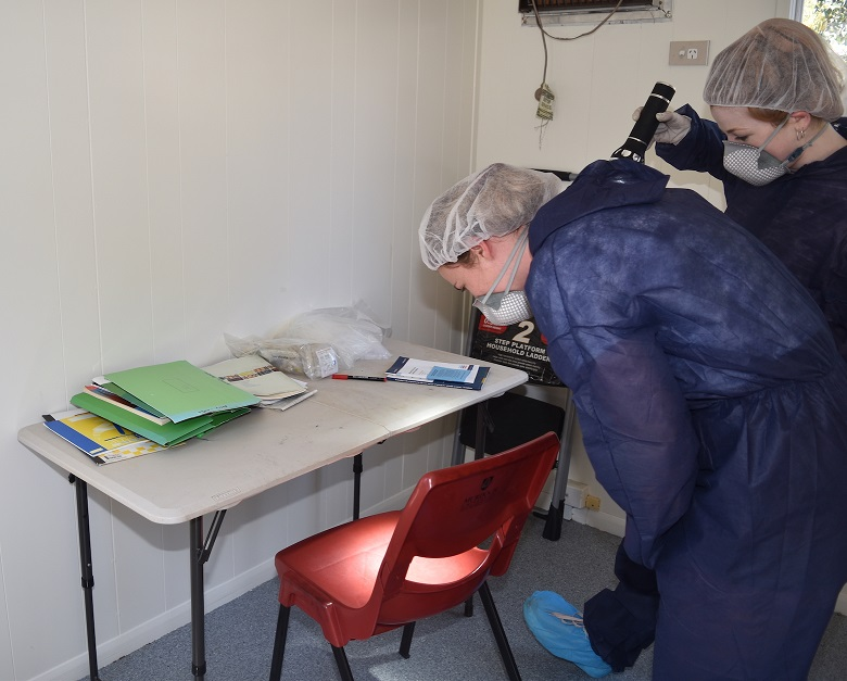 Forensic Students Cody and Tiana examining a mock crime scene at Murdoch
