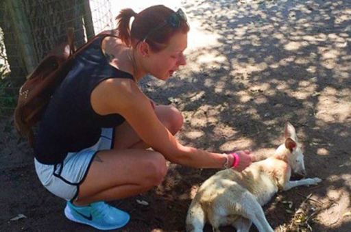 International student Rebecka Hillbertz petting kangaroo